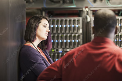 Caucasian woman in a large computer server farm