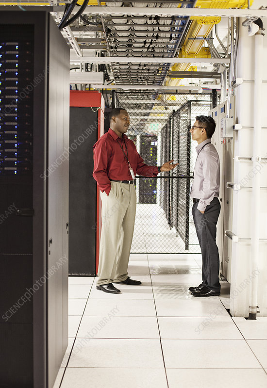Computer technicians working in a server farm