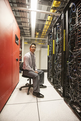 Technician working with servers at a server farm