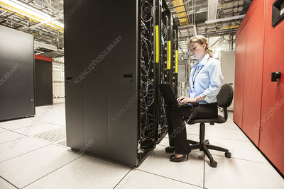 Woman technician working on servers at sever farm