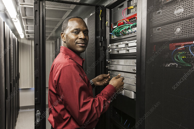 Technician working on servers in server farm