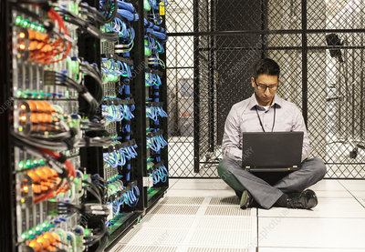 Hispanic technician doing tests at a server farm