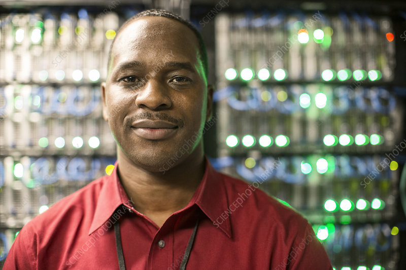 Black man technician in a computer server farm