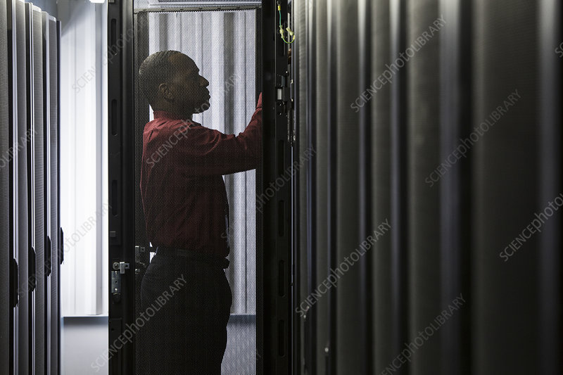 Technician working in a server farm