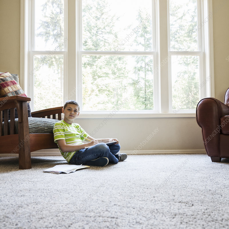 Young boy at home doing homework