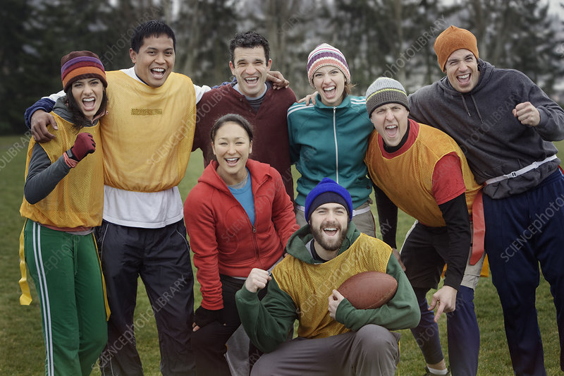 Mixed race team, friends playing football