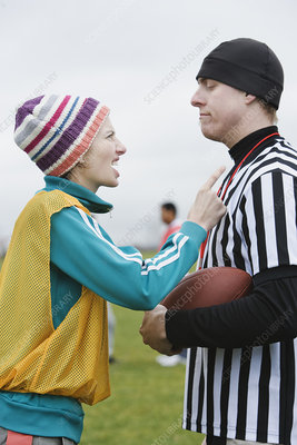 Woman player arguing with a referee