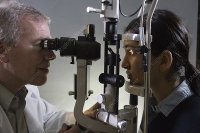 Ophthalmologist using slit lamp tanometer