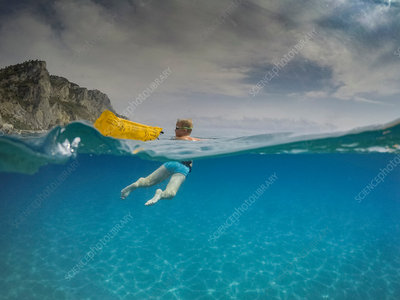 Boy swimming in blue sea, Liguria, Italy