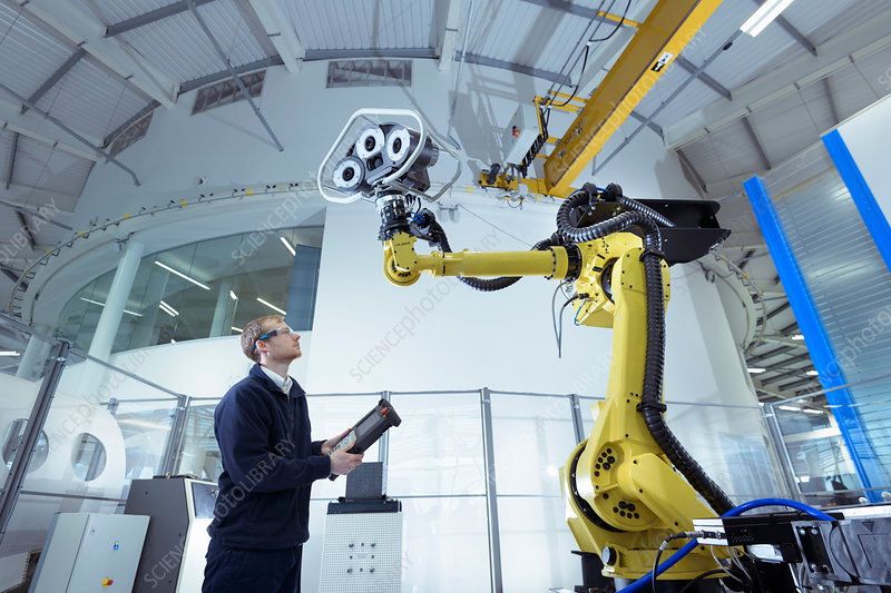 Engineer with robot, low angle view