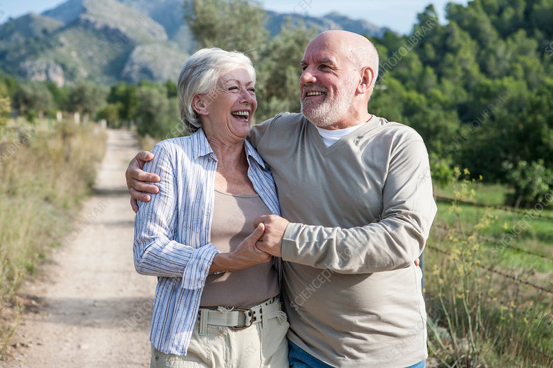 Senior couple walking together in rural setting