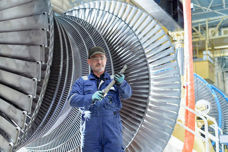 Portrait of engineer with turbine blade