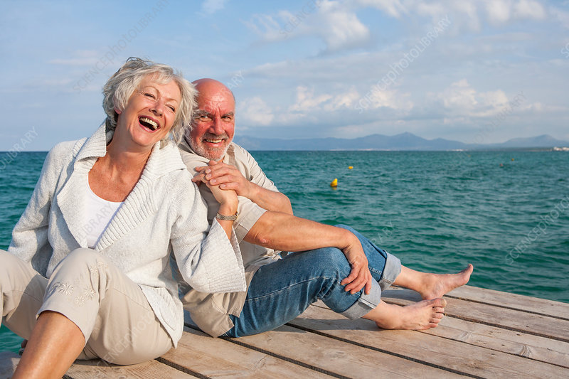 Couple hugging and laughing on jetty