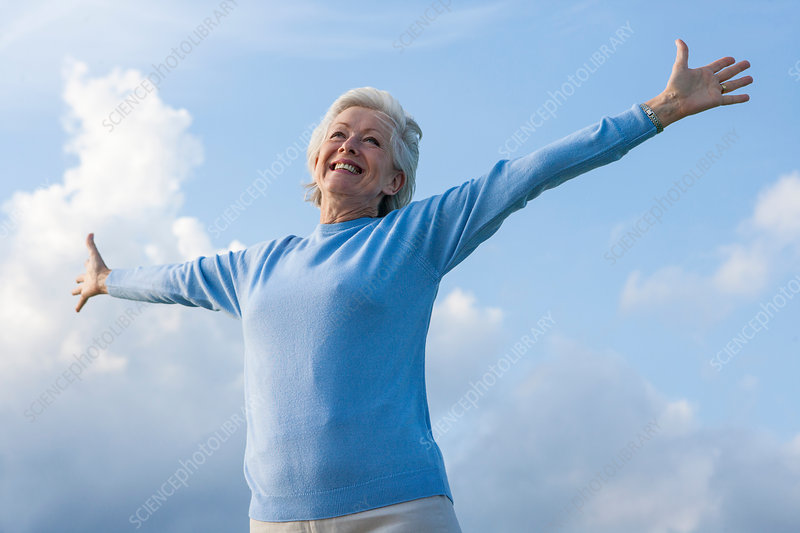 Carefree woman with arms open