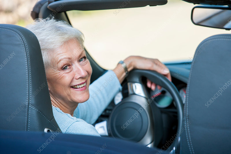 Portrait of senior woman in convertible car
