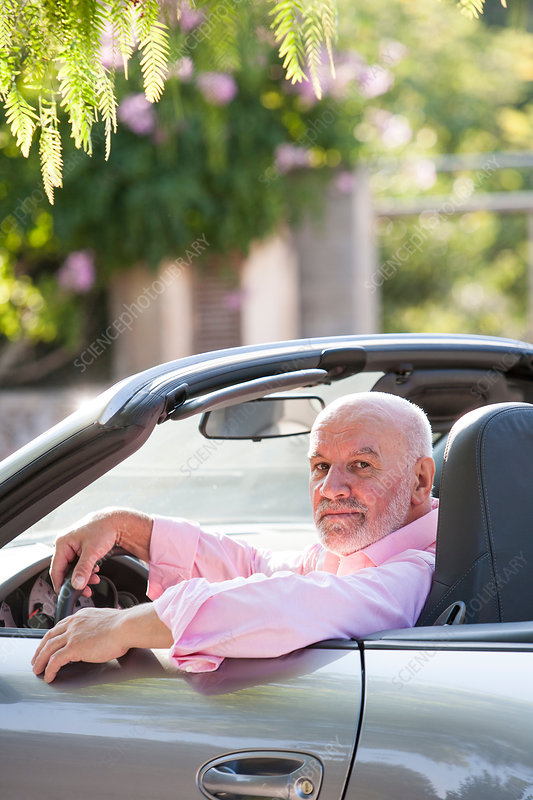 Portrait of senior man in convertible car