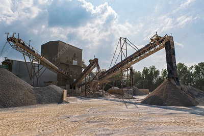 Crusher and conveyor belts at gravel mine, Asia