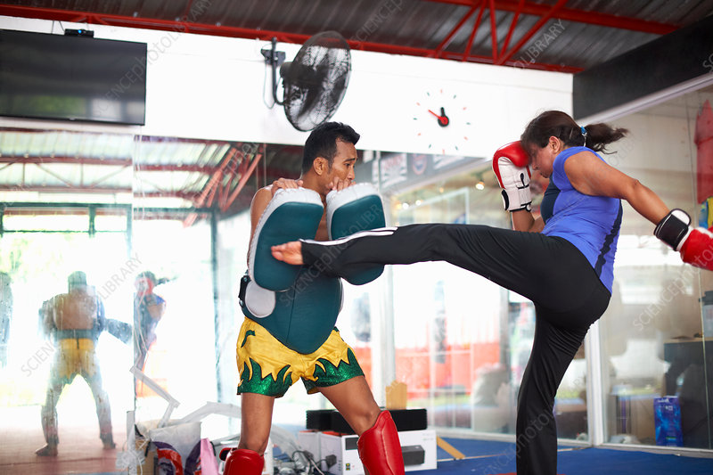 Mature woman practicing kickboxing