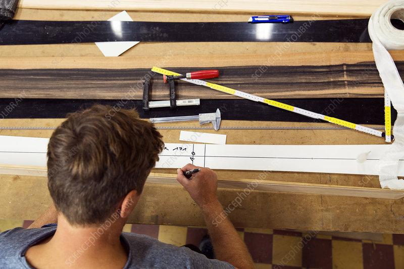 Man in workshop, making ski equipment, overhead view