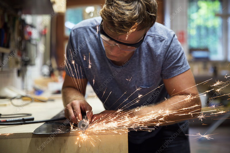 Man in workshop, making ski equipment