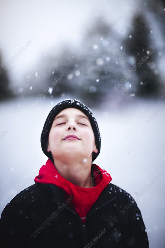 Portrait of boy in falling snow
