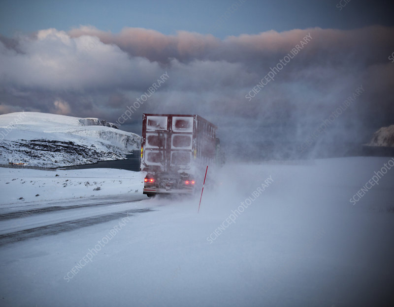 Truck driving snow covered road, Finnmark, Norway