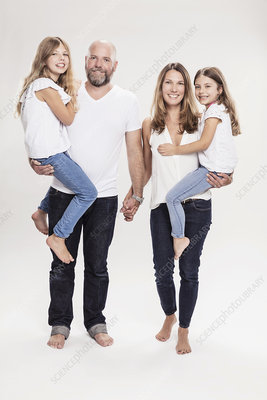 Mature couple carrying two daughters