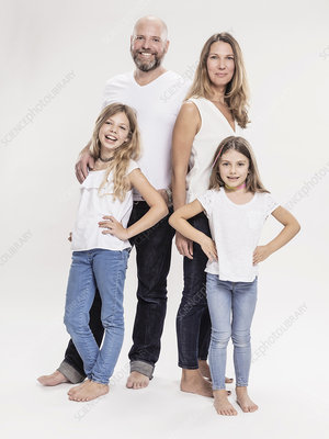 Mature couple with two daughters