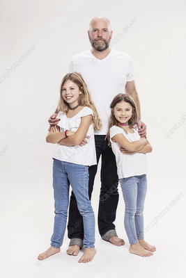 Mature man with two daughters