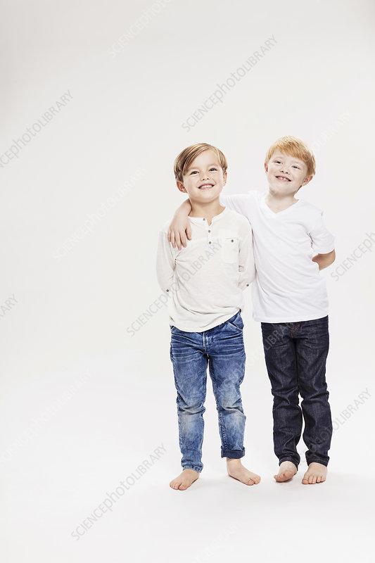 Studio portrait of two boys, full length