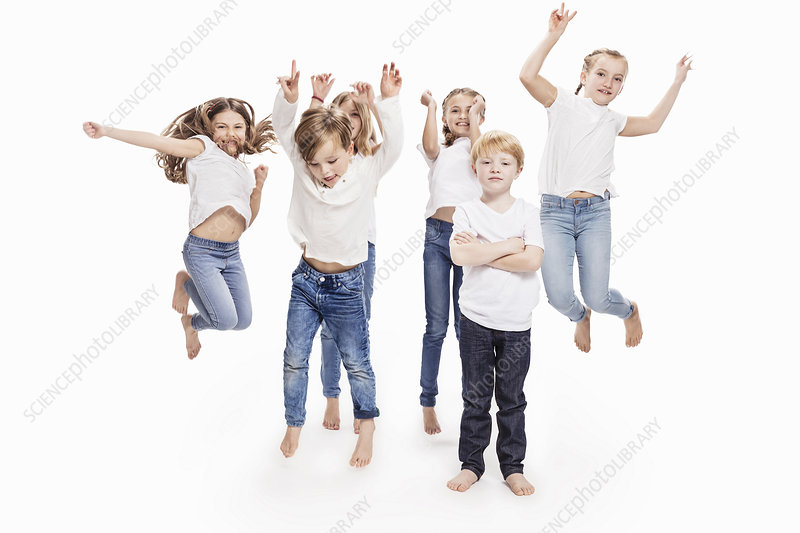 Two boys and four girls having fun jumping mid air