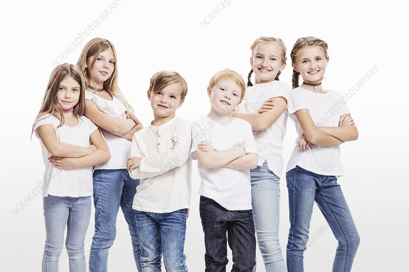Two boys and four girls posing with arms folded