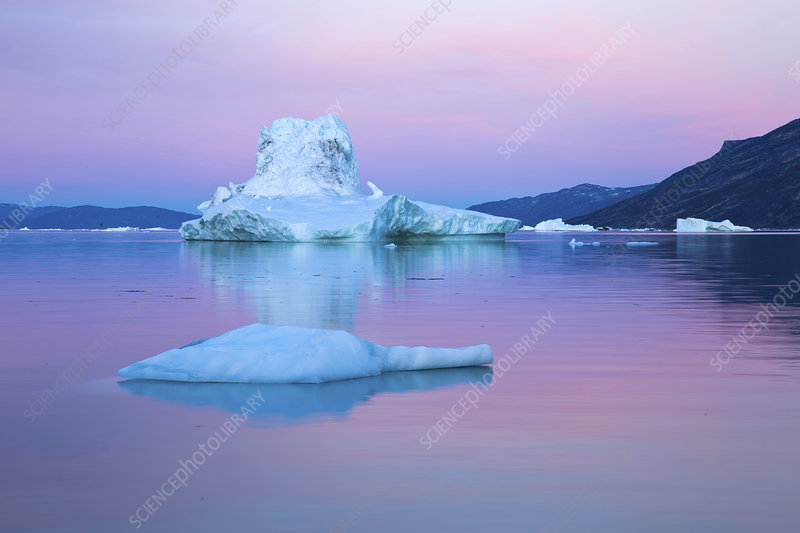 Icebergs in calm water during midnight sun, Greenland