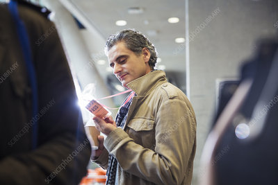 Businessman looking at identification pass