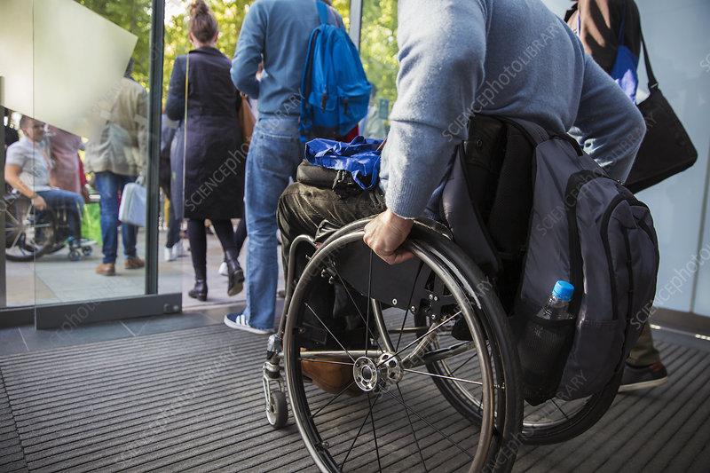 Man in wheelchair leaving office