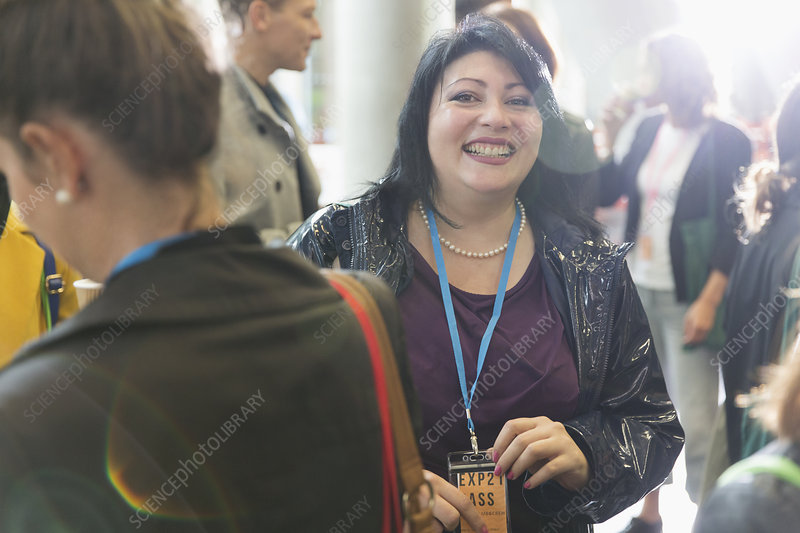 Portrait smiling, enthusiastic woman at conference