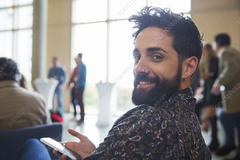 Businessman with beard using smart phone