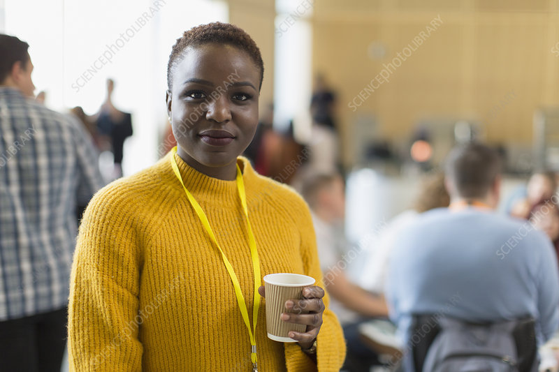 Portrait businesswoman drinking coffee at conference