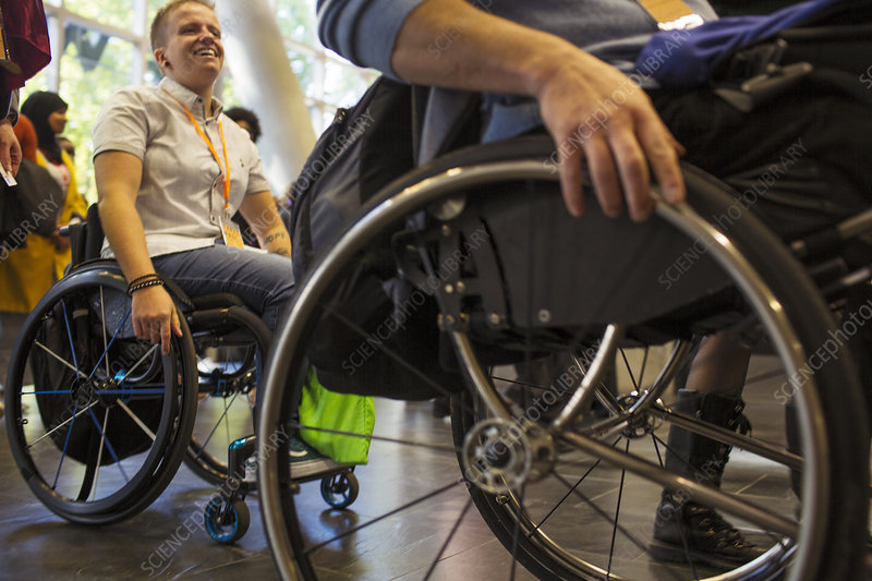 People arriving in wheelchairs