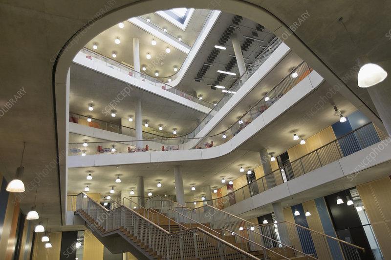 Modern office lobby atrium with balconies