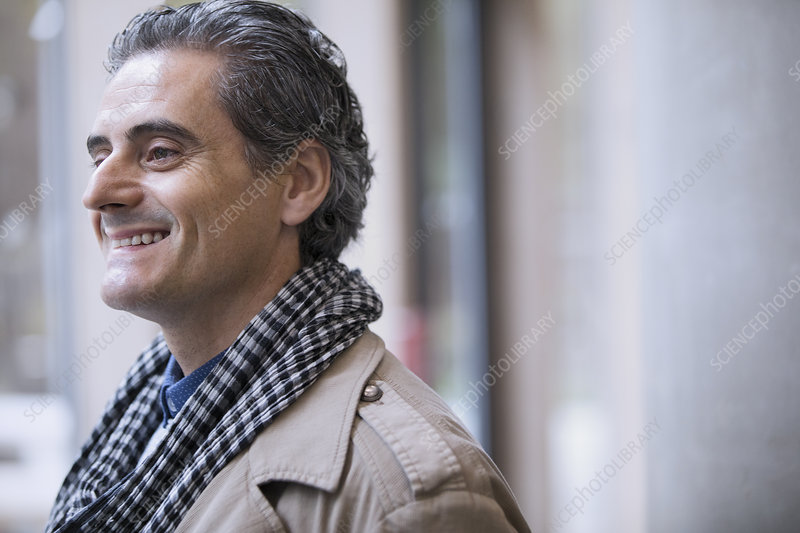 Smiling businessman in scarf