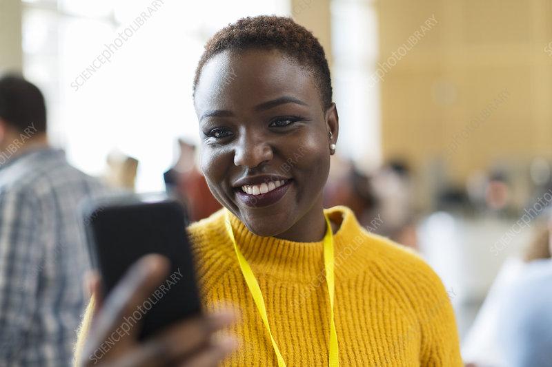 Smiling businesswoman using smart phone