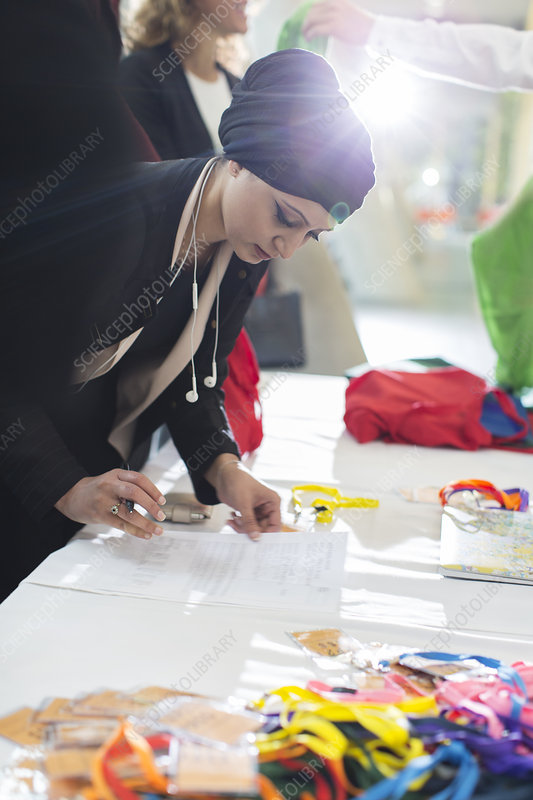 Businesswoman wearing headscarf at conference