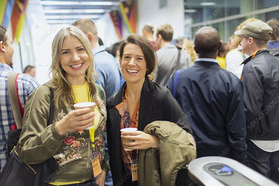 Portrait smiling, women drinking coffee at conference
