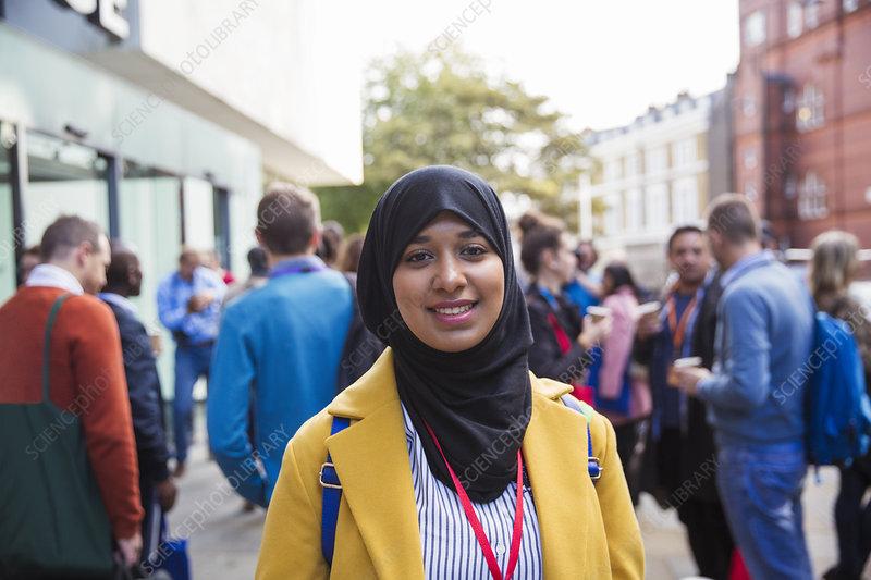 Portrait smiling, businesswoman in hijab on street