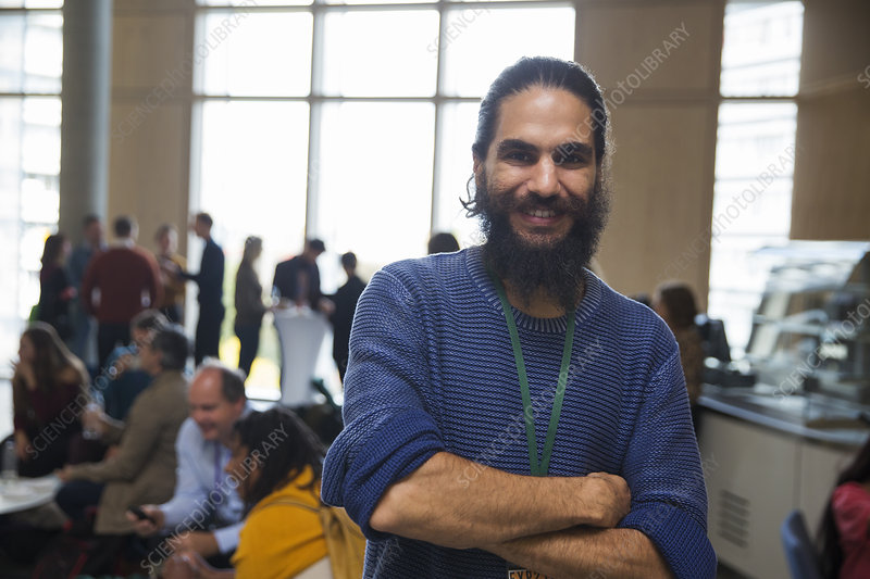 Portrait smiling man with beard at conference