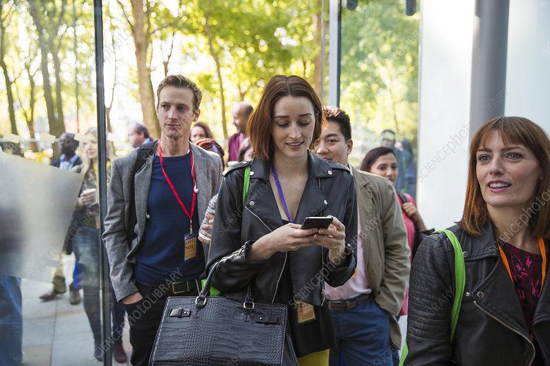 Businesswoman arriving, entering doorway