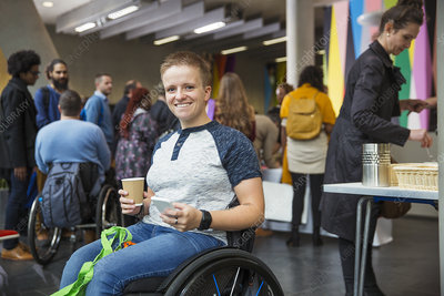 Portrait woman in wheelchair at conference