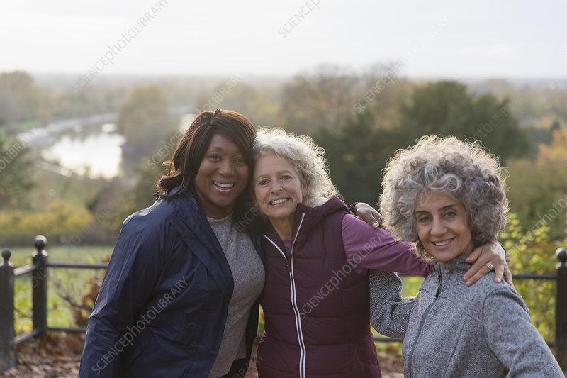 Portrait active senior women friends in autumn park