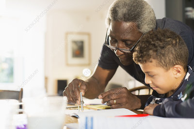 Grandfather helping grandson with geometry homework